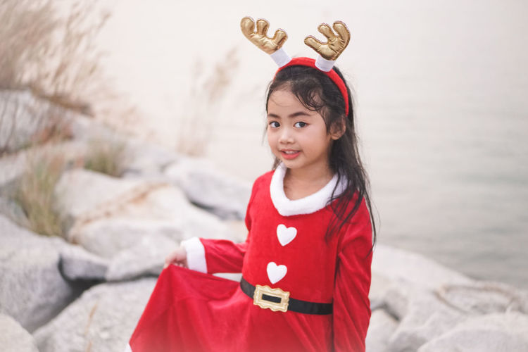 Little Santy/Reindeer on Stone dam at sea side.Little Girl in Santa Claus dress with Reindeer Headband. Santy  Santa Santa Claus Reindeer Stone Dam Sea Sea Side Thailand Winter Fashion Girl Little Girl Kid Asian  One Person Childhood Child Red Girls Portrait Looking At Camera Clothing Innocence Front View Women Cute Females Focus On Foreground Standing Hair Holding Hairstyle