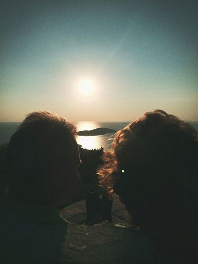 Two People Sea Rear View Real People Leisure Activity Sunset Lifestyles Sky Women Men Nature Togetherness Outdoors Water Beauty In Nature People Adult Day