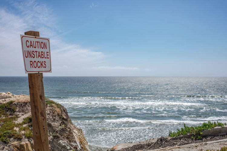 On the edge // Beach Calm Caution Caution Sign Cliff Coastline Horizon Over Water Idyllic Information Information Sign Nature No People Ocean Outdoors Rock Rock - Object Scenics Sea Seascape Shore Sunny Day Text USAtrip Water Wave