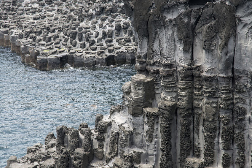 view of columnar joints (jusangjeolli) at Jungmun Tourism Complex in Jeju Island, South Korea Beauty In Nature Close-up Columnar Joints Day JEJU ISLAND  Jungmun Tourism Complex Jusangjeolli Nature No People Outdoors Rock - Object Rock Formation Seaside Textured  Water