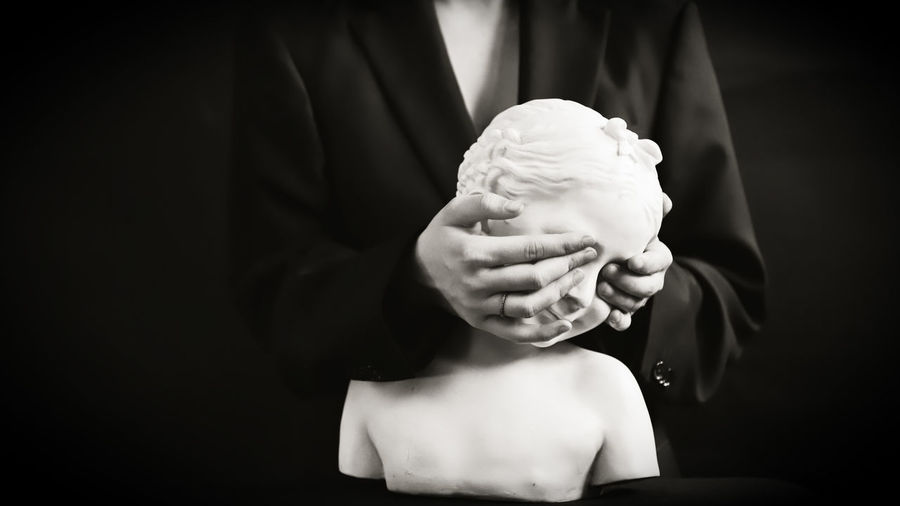 Statue Statues And Monuments Statues Eyes Shut Eyes Closed  Black And White Creativity Creative Portrait Women Woman Woman Portrait Hands Holding Midsection One Person Hand Indoors  Real People Black Background Human Body Part Indulgence Lifestyles Focus On Foreground Human Hand