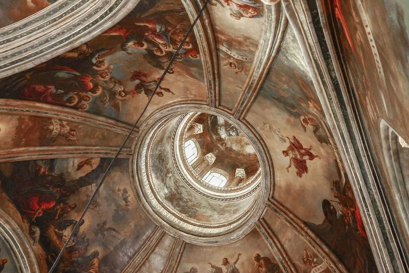 Directly below shot of ceiling of historic building