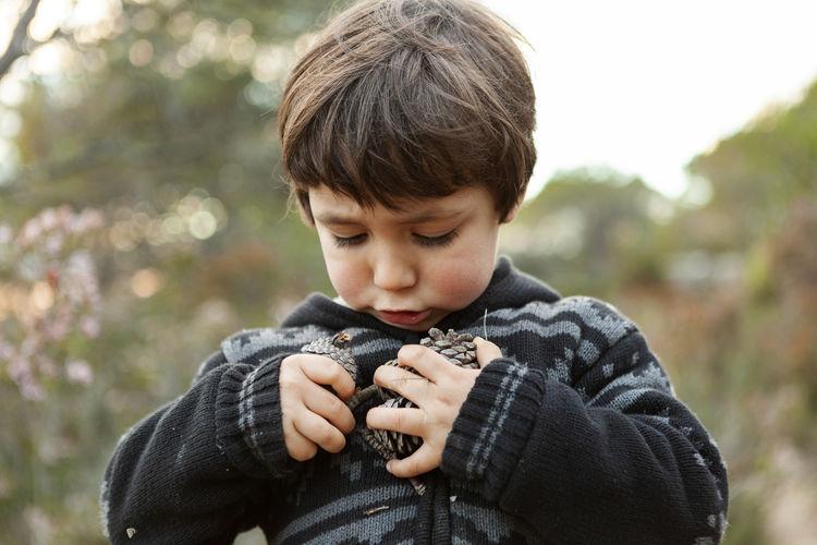 Portrait of boy holding camera