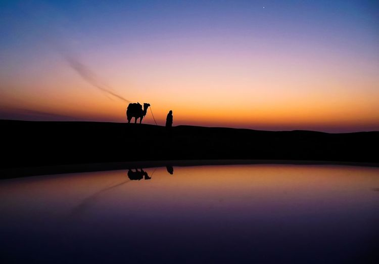 The Master Deserts Around The World Beauty In Nature Clear Sky Dawn Of A New Day Leisure Activity Nature Outdoors Real People Scenics Silhouette Sky Sunrise Sunset Tranquil Scene Tranquility Water EyeEmNewHere My Best Photo