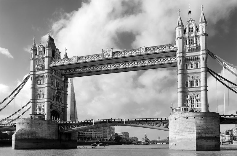 Low Angle View Of Tower Bridge Over Thames River Against Cloudy Sky