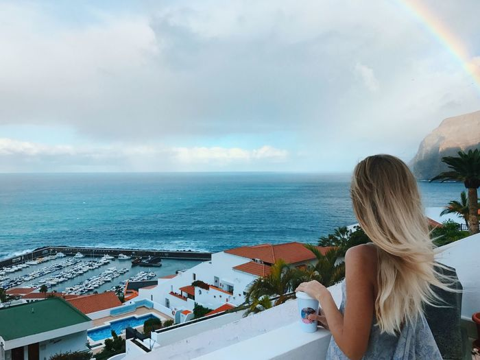 Sea Water Sky One Person Rear View Cloud - Sky Horizon Over Water Leisure Activity Adult Beauty In Nature Real People Looking At View Day Young Women Outdoors Lifestyles Women Nature Architecture Horizon