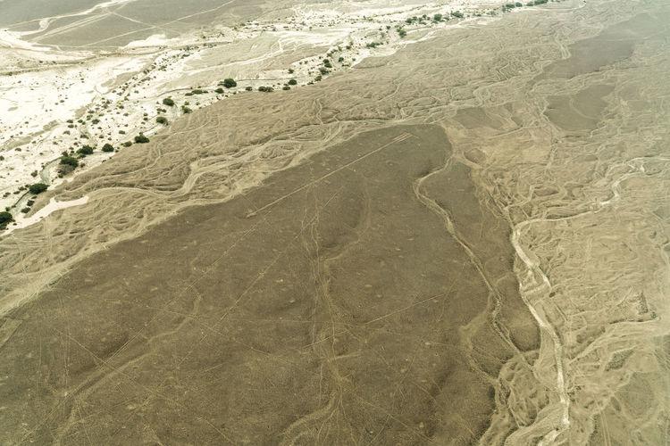 Tire tracks on sand dunes