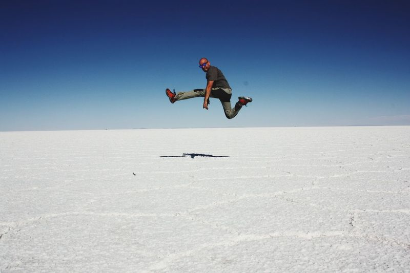 Mid-air Lifestyles Clear Sky One Person Real People Young Adult Energetic Day Outdoors Nature Beauty In Nature Scenics Nature Salar De Uyuni