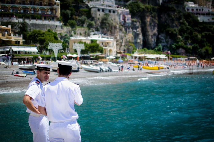 Officers watching over Positano harbour, Italy Beach Blue Sea Coast Coastline Harbour Italy Looking Mediterranean  Navy Officers Positano Positano, Italy Sea Standing Travel Photography Water White Uniform FreshonEyeem