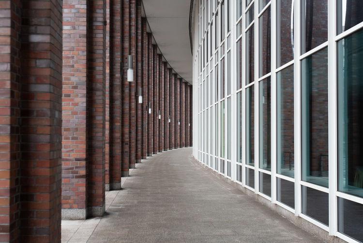 Empty arcade corridor of building