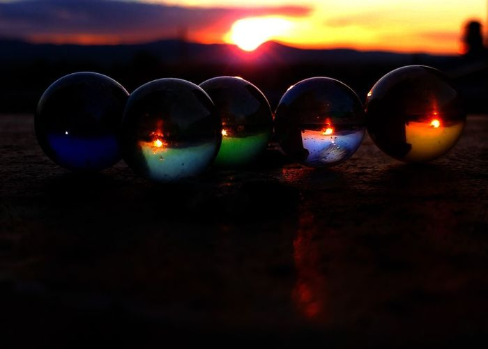 Reflection No People Illuminated Cloud - Sky Sky Water Red Sunset Close-up Outdoors Beach Flame Night Nature Diya - Oil Lamp EyeEm Selects SoulArt EyeEmNewHere ToolWiz Photos Photo Editor Art Photography Art Is Everywhere EyeEm Best Edits Sphere Glass Sphere Glass Objects