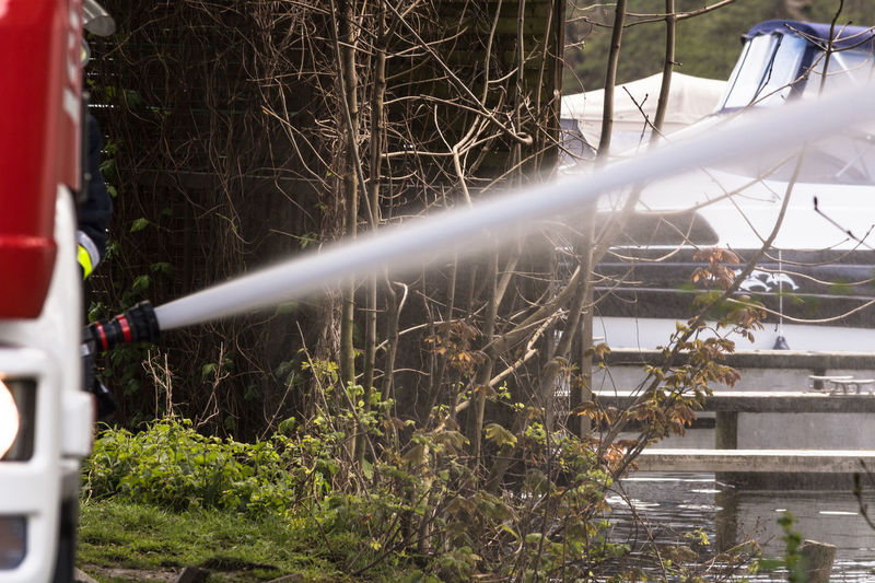 Fire department sprayed extinguishing water from fire hoses during an exercise. Close-up Day Exercise Exthiguishing Water Fire Hose First Eyeem Photo Grass Growth Nature No People Off Fire Outdoors Pipe - Tube Plant Spraying Tree Water
