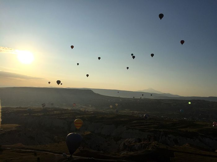 Hot Air Balloons Over Cappadocia Against Sky During Sunset