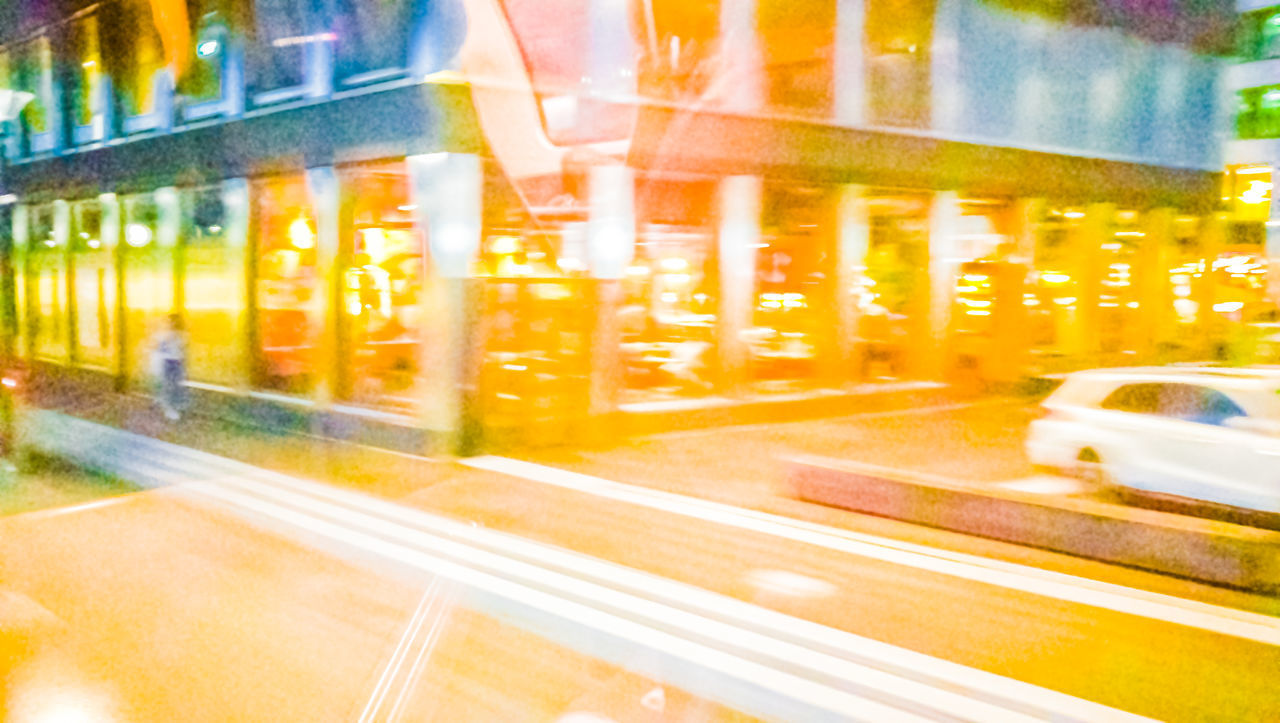 BLURRED MOTION OF LIGHT TRAILS ON ROAD