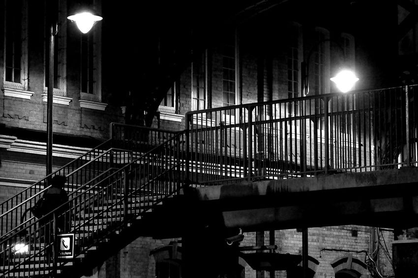Crossing the foot bridge at Bournemouth Central Station. Black & White After Dark Train Station Railways Dorset