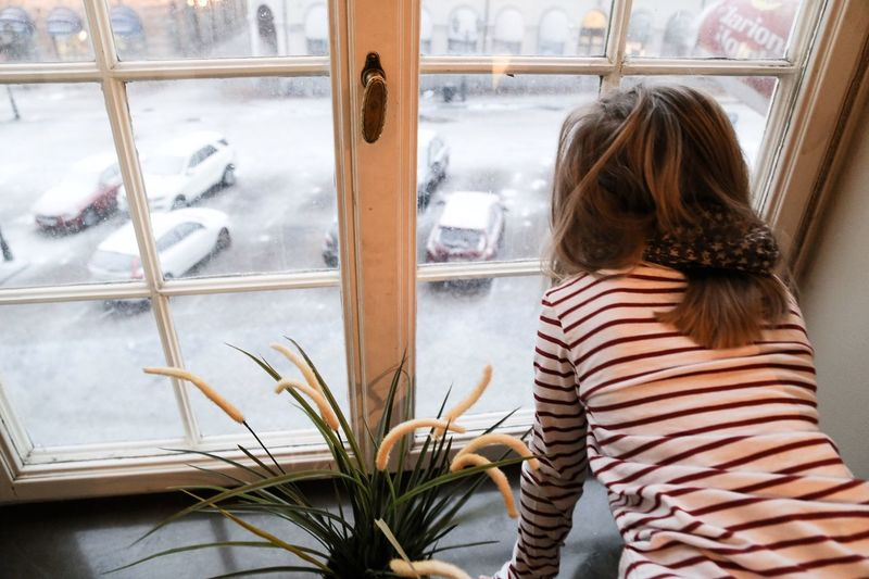 The Photojournalist - 2016 EyeEm Awards Girl Window Tranquil Scene Home Interior Looking Out Of The Window Looking Out My Window Looking Through Window Cute Child Childhood Snowing Snow Day Snowy First Snow Wintertime Winter