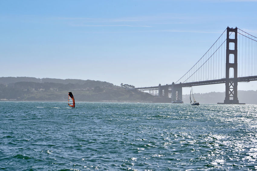 Sailing Past The Golden Gate Bridge 5 Windsurfer Windsurfing Sailboat Ferry Sailing San Francisco Bay Golden Gate Bridge South Anchorage Fort Point Bridge Architecture Bridge Tower & Span Silhouettes Eastbay Hills Hills Of San Francisco Seascape Landscape_Collection Landscape_photography Riding The Winds A Day On The Bay Enjoying Life Nature Nature_collection Beauty In Nature Scenic Watersports