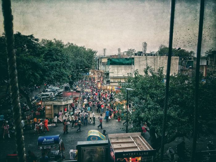 FULL OF PEOPLE Market People Crowd Busy Notime Photography Click Ramdomclick Experiment Tree City Patriotism Sky Architecture Built Structure Bazaar Price Tag For Sale Street Market Stall Market Stall Parking Retail Display First Eyeem Photo