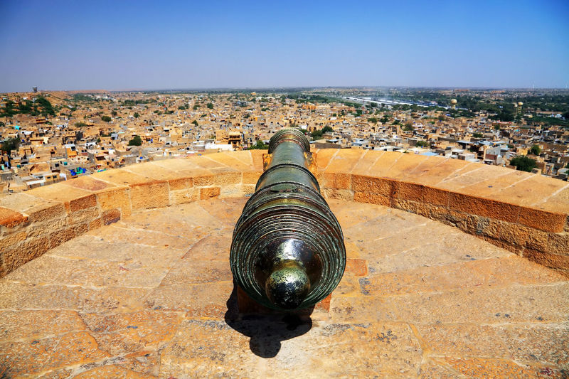Canon On Fort Overlooking Townscape Against Clear Sky