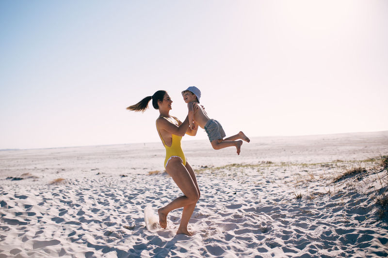 Beach Land Sky Sea Two People Leisure Activity Full Length Sand Real People Clear Sky Lifestyles Togetherness Water Young Adult Horizon Women Adult Young Women Nature Beauty In Nature Horizon Over Water Positive Emotion