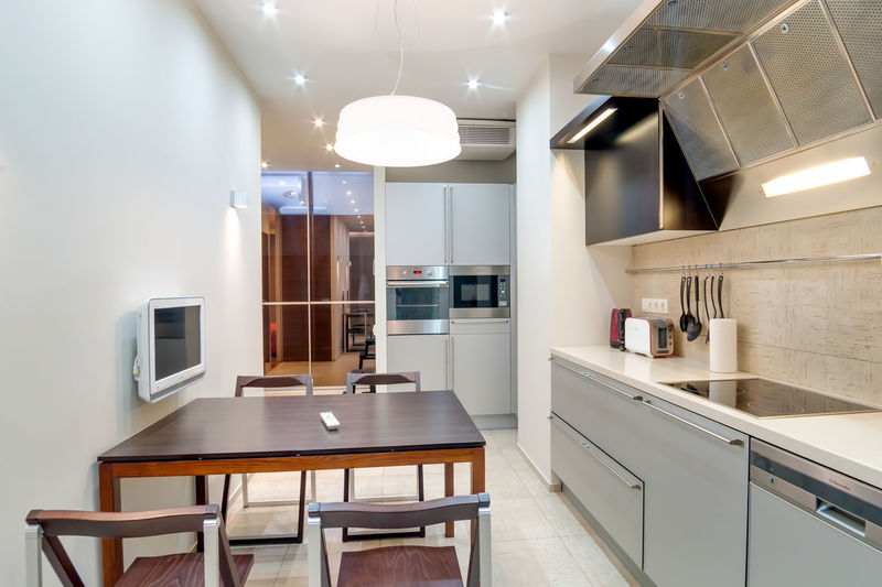 Home Domestic Room Domestic Kitchen Kitchen Furniture Home Interior Indoors  Lighting Equipment Seat Modern Table No People Home Showcase Interior Kitchen Counter Appliance Absence Chair Household Equipment Illuminated Architecture Cabinet Luxury Flooring Ceiling Oven