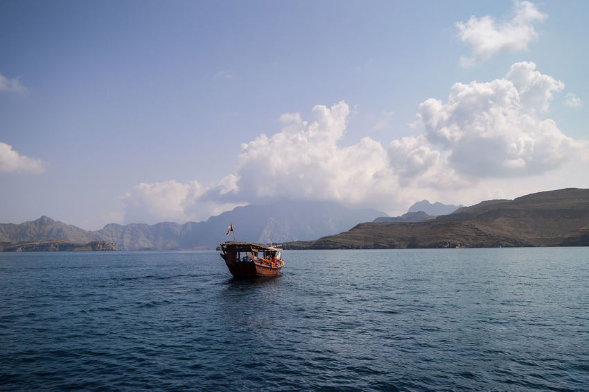 Musandam Musandam Oman Oman Travel Beauty In Nature Boat Cloud - Sky Cruise Dhow Dhowcruise Mountain Mountain Range Nature Oman_photography Outdoors People Sailing Scenics Sky Tranquility Transportation Travel Destination Water Waterfront
