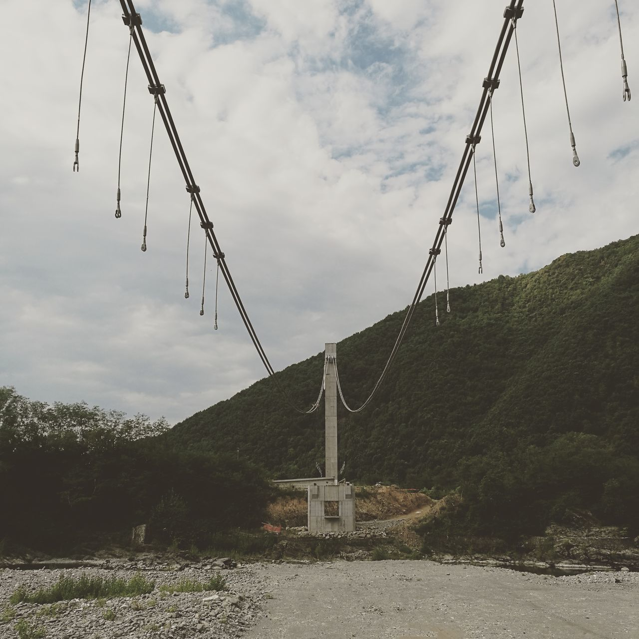 cloud - sky, sky, cable, connection, no people, nature, outdoors, day, tranquil scene, scenics, tranquility, mountain, overhead cable car, low angle view, landscape, beauty in nature, tree, ski lift