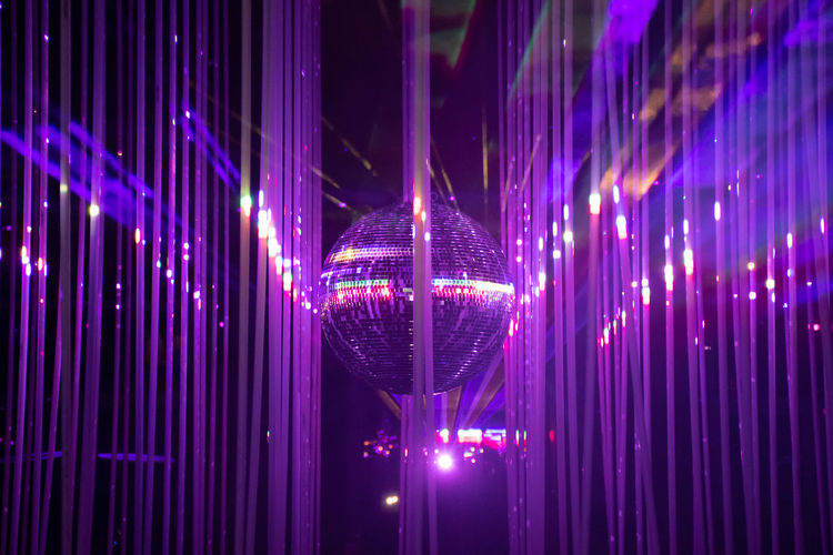 Full frame shot of illuminated lighting equipment at night