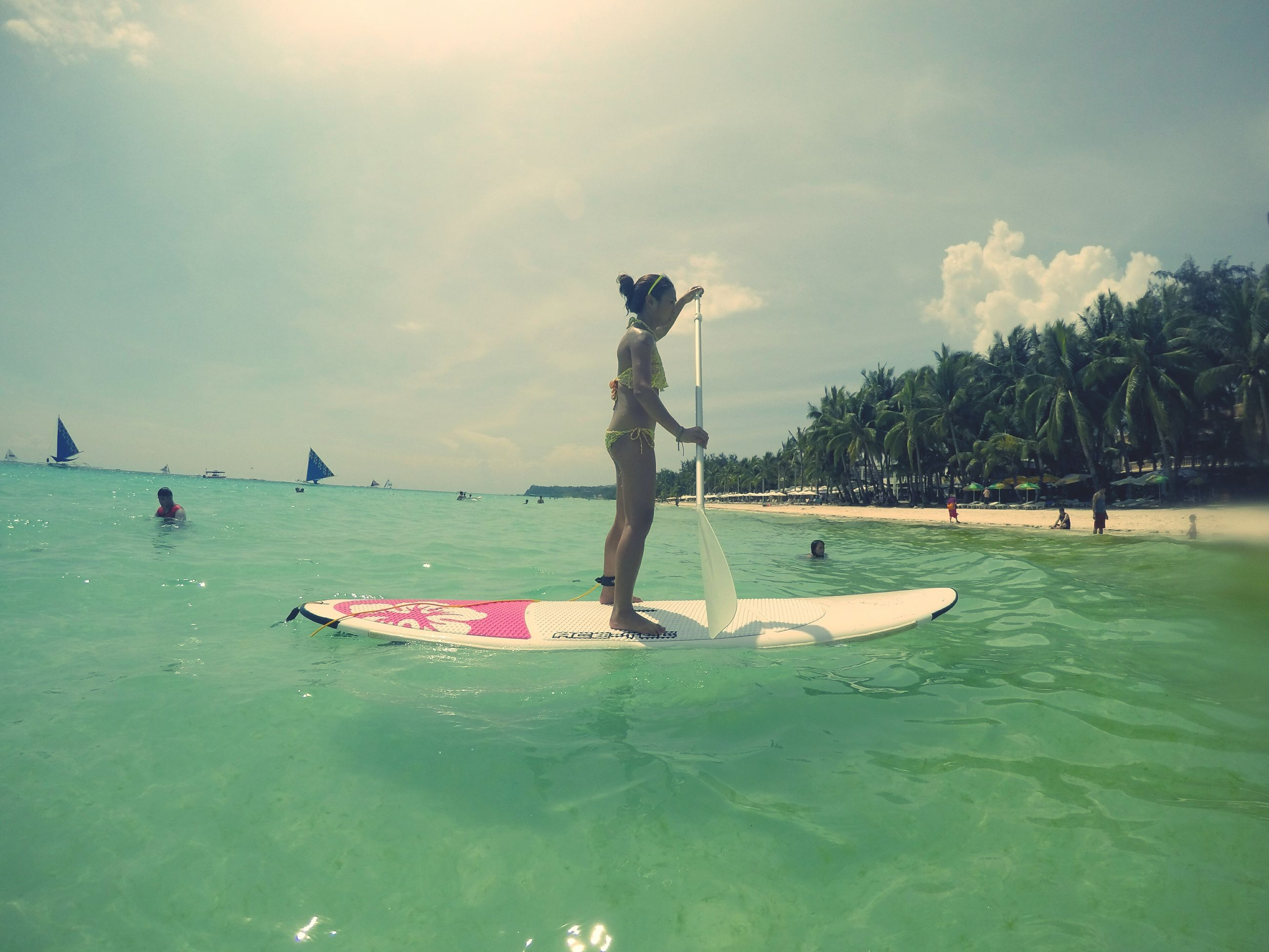 water, sea, sky, leisure activity, waterfront, lifestyles, cloud - sky, vacations, nature, tree, day, tranquility, enjoyment, men, scenics, travel, outdoors, sculpture, incidental people