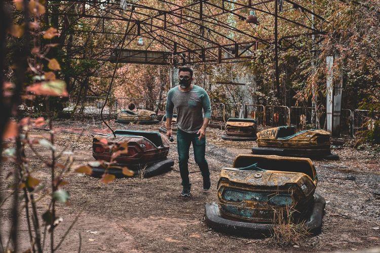 Man walking at abandoned amusement park