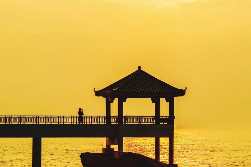 Selfie alone during Sunrise Selfie Alone Water Built Structure Sky Sea Nature Tranquility Beauty In Nature Tranquil Scene Gazebo Outdoors Silhouette Clear Sky