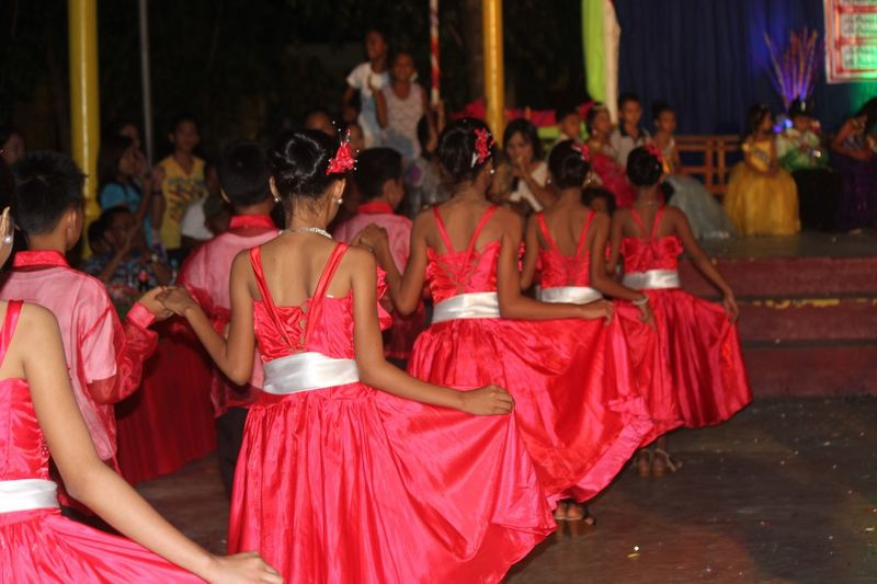 Dancing girls Girls Dancers Uniformity Presentatation Cotillion Dance Photography Group Of People Crowd Real People Large Group Of People Sitting Traditional Clothing Women Clothing Rear View Red