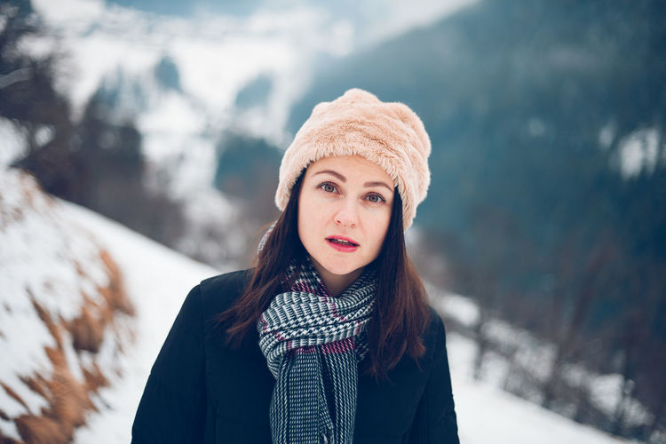Portrait Of Beautiful Mid Adult Woman Standing On Snow Covered Field