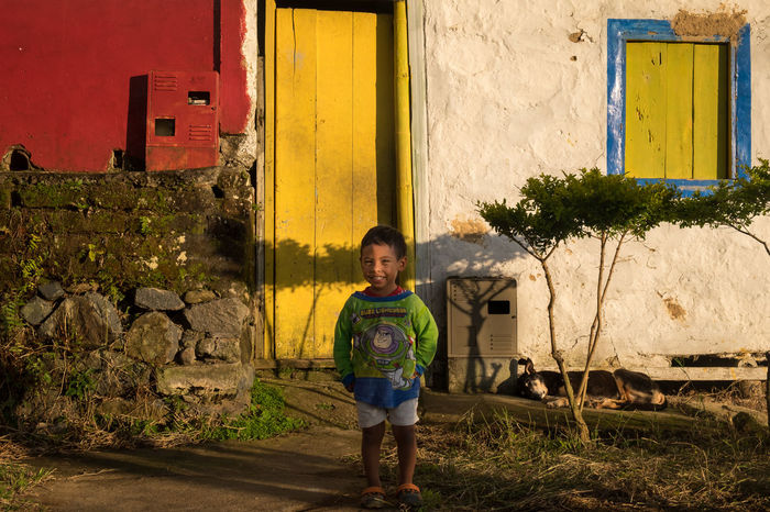 Little boy in front of his house, in Jericó, Colombia. Buzzlightyear Colombia Yellow Red And Blue Colombia ♥  Horizon Over Water Jerico Jerico Colombia Portrait Sleeping Dogs 2014 Sunset
