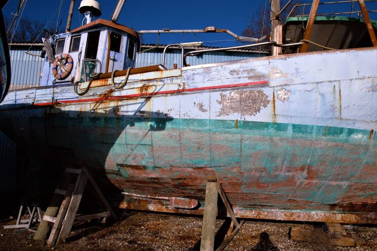 Wintertime Damaged Day Fishing Boat Nautical Vessel No People Outdoors Rusty Sunny Day