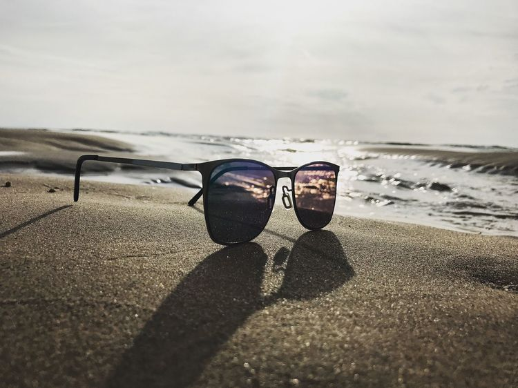 Sunglasses Beach Sea Sand Sky Sunlight Day Shadow Nature Horizon Over Water Outdoors Water Cloud - Sky Vacations No People Close-up Beauty In Nature