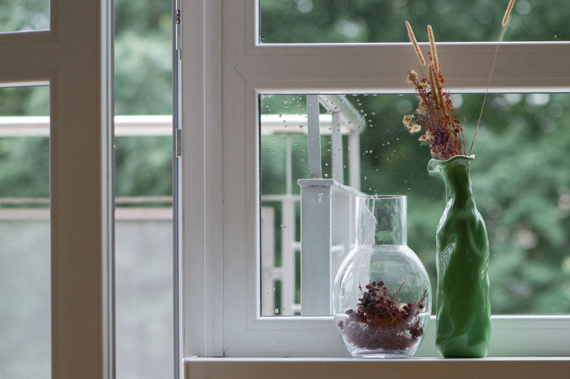 Interior view with a window and rain drops, open balcony door and vases with dry flowers Window Reflection Rain Drop Droplet interior Design Decoration Vase Still Life Flowers Dry Open Door Glass balcony Green Window Sill Windows Design Interior Summer Modern Architecture Style Neat Lines And Shapes Droplets open Lieblingsteil EyeEmNewHere Art Is Everywhere The Still Life Photographer - 2018 EyeEm Awards