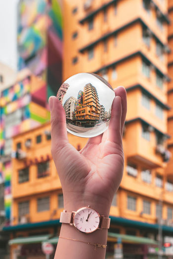 Kam Ning Building 金寧大廈 Glass Ball Crystal Ball Reflection EyeEm Best Shots EyeEm Selects EyeEm Gallery Tai Nan Street Tong Mi Sham Shui Po Human Hand Hand Holding One Person Human Body Part Architecture Focus On Foreground Real People Time Watch Built Structure Building Exterior Wristwatch Clock Education Body Part Close-up Leisure Activity Lifestyles Finger Studying The Creative - 2019 EyeEm Awards