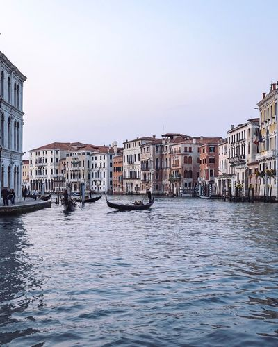 EyeEm Selects Venice Architecture Building Exterior Built Structure Water Canal Clear Sky Waterfront Wooden Post Nautical Vessel Transportation Outdoors Mode Of Transport Day Travel Destinations Gondola - Traditional Boat No People Sky City Venice, Italy Venezia Italy