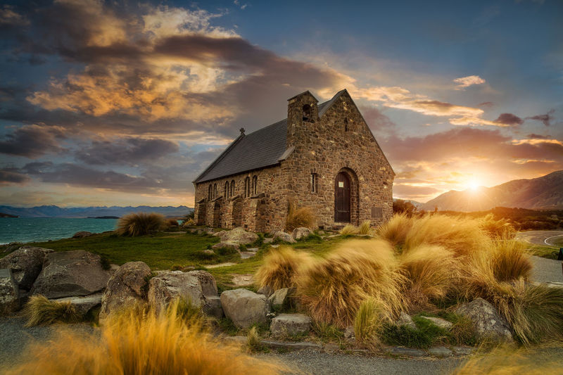 Architecture Beautiful Scene Of Church Of Good Shepherd, New Zealand Beauty In Nature Building Exterior Built Structure Cloud - Sky Day Grass Nature New Zealand Landscape No People Outdoors Scenics Sky Sunset Water