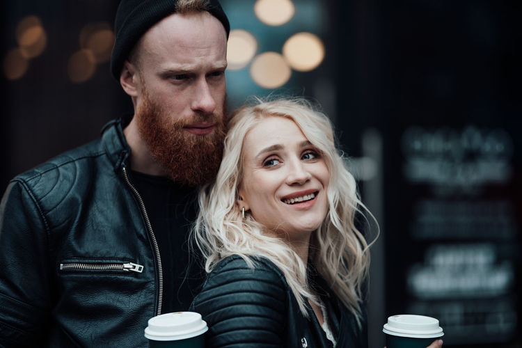 Portrait of young couple with coffee