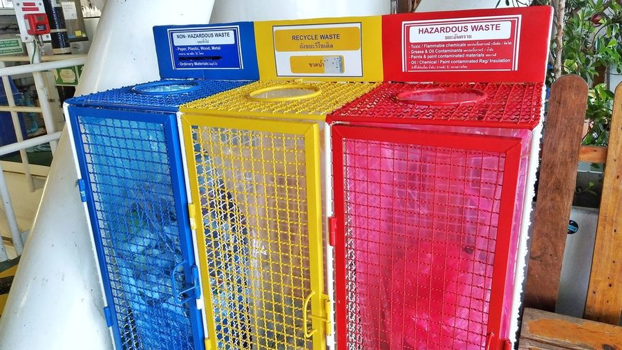 The bin separate colorful. Blue Yellow Red Bin Seperate Waste Waste Management Multi Colored Business Finance And Industry Communication Text Close-up For Sale Market Stall