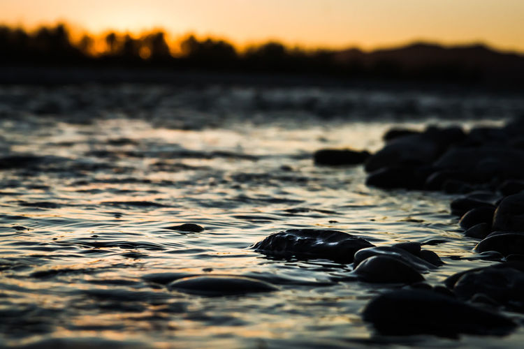 The river flows Acqua Dark Piave Tramonto Beach Bokeh Close-up Corrente Crepusculo Day Dusk Fiume Flower Flusso Nature No People Outdoors Pebbles River Scenics Sky Sunset Tranquility Warm Colors Water