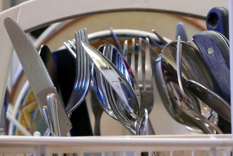 Close-up of forks and spoons in container