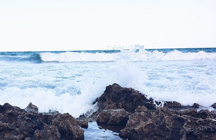 EyeEm Selects Sea Wave Horizon Over Water Nature Rock - Object Beauty In Nature Beach Water Clear Sky No People Scenics Motion Outdoors Day Power In Nature Sky Waves Blue