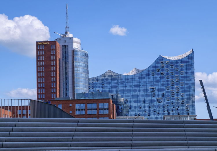 Elbphilharmonie concertn hall behind city stairs by day, hamburg, germany