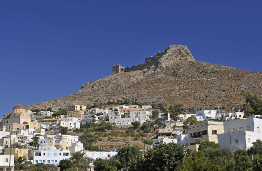 Panteli (or Pandeli) castle, Leros island, Dodecanese, Greece Ancient Castle Dodecanese Greek Leros Island Mediterranean  Travel Architecture Blue Building Exterior Copy Space Day Europe Fortress Greece Hilltop Leros Mountain No People Pandeli Panteli Pantelimon Sky Village