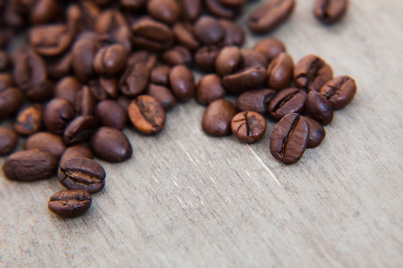 Fine roasted coffee beans on wooden background Background Coffee Coffee Beans Coffee Break Coffee Crop Coffee Culture Coffee Growing Coffee Time Fair Trade Roasted Coffee Bean Wooden Background