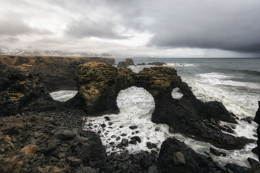 Landscape in Iceland Beauty In Nature Cloud Cloud - Sky Cloudy Coastline Day Horizon Over Water Idyllic Nature No People Outdoors Overcast Rock Rock - Object Rock Formation Scenics Sea Shore Sky Tourism Tranquil Scene Tranquility Travel Destinations Water Weather