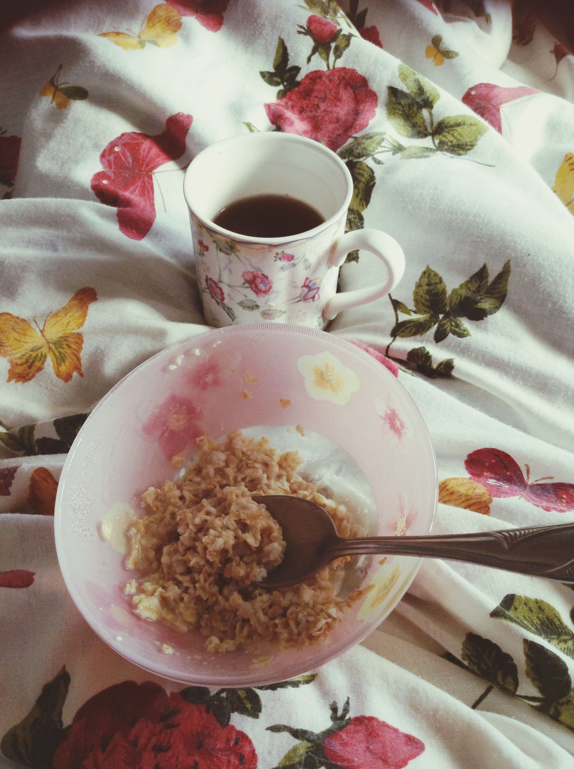 indoors, food and drink, freshness, table, plate, food, still life, drink, high angle view, spoon, refreshment, ready-to-eat, coffee cup, bowl, healthy eating, flower, saucer, tablecloth, cup, serving size